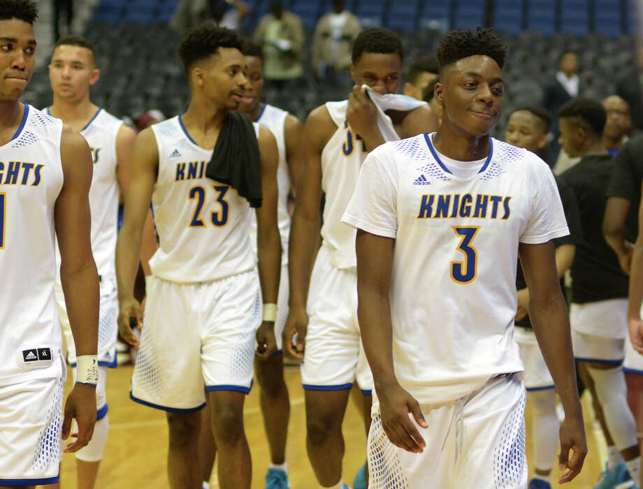Elkins junior guard Chandler Jacobs (3) tries to control his smile after the Knight's 101-73 win over Fort Worth Dunbar in their Class 5A boys basketball state semifinal at the Alamodome in San Antonio on Thursday, Mar. 10, 2016. (Photo by Jerry Baker/Freelance) Photo: Jerry Baker Jerry Baker, For The Houston Chronicle