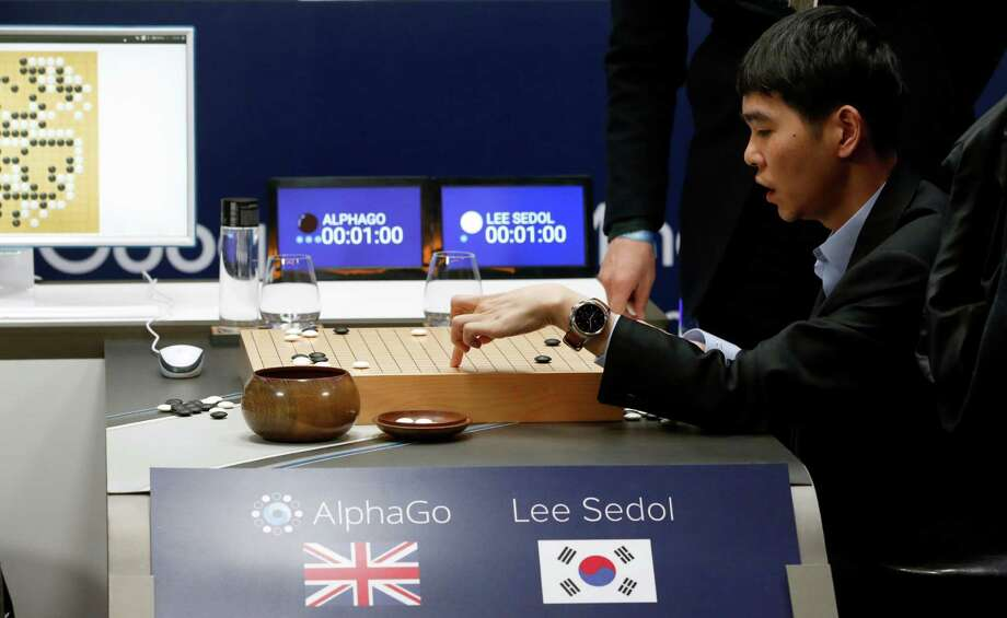 """South Korean professional Go player Lee Sedol reviews the match himself after finishing the second match of the Google DeepMind Challenge Match against Google's artificial intelligence program, AlphaGo in Seoul, South Korea,  March 10, 2016. The human Go champion said he was left """"speechless"""" after his second straight loss to Google's Go-playing machine on Thursday in a highly-anticipated human versus machine face-off. Photo: Lee Jin-man /AP / AP"""