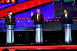 CORAL GABLES, FL - MARCH 10:  Republican presidential candidates, Sen. Marco Rubio (R-FL), Donald Trump and Sen. Ted Cruz (R-TX) are seen during the CNN, Salem Media Group, The Washington Times Republican Presidential Primary Debate on the campus of the University of Miami on March 10, 2016 in Coral Gables, Florida. The candidates continue to campaign before the March 15th Florida primary.  (Photo by Joe Raedle/Getty Images)