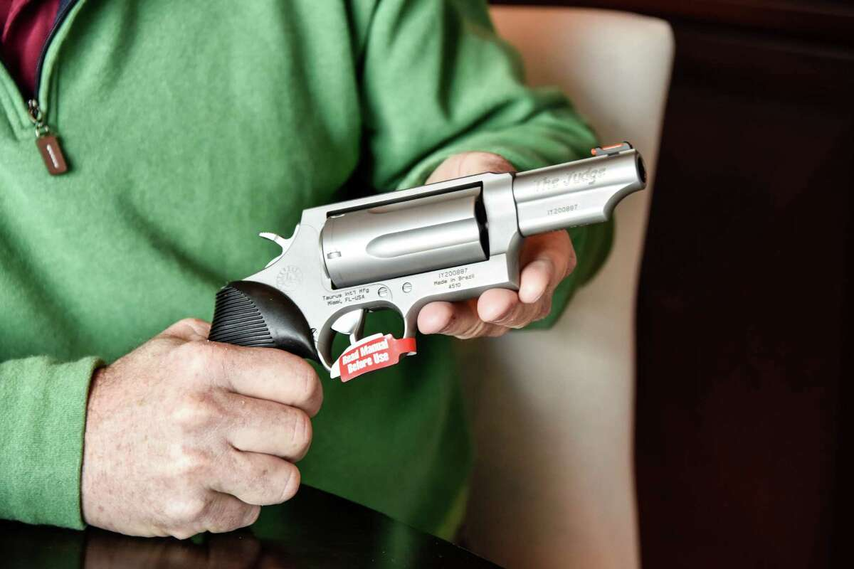 """Lance Toland is the owner of Lance Toland Associates, an aviation insurance company with three offices in Georgia. He requires his employees to get a concealed-carry permit and undergo training. He also issues a Taurus revolver known as """"The Judge"""" to each of them."""