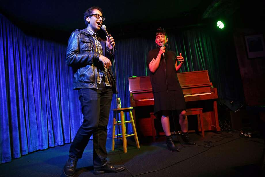 Richard Sarvate and Krista Fatka go head to head during Comedy Roast BattleSF at Doc's Lab in San Francisco. Photo: Scott Strazzante Scott  Strazzante, The Chronicle