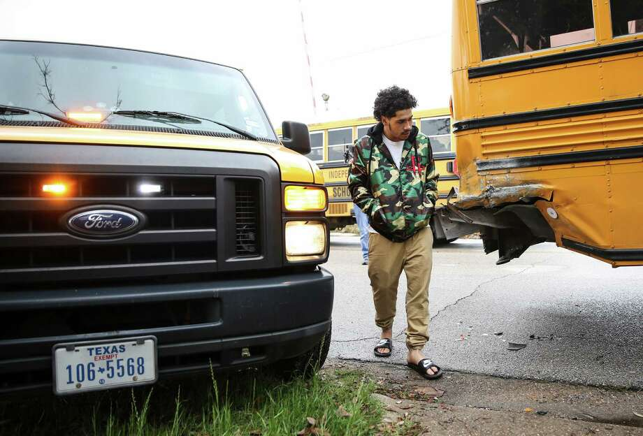 Alexander Jimenez, 19,looks at the damage done to a school bus he hit