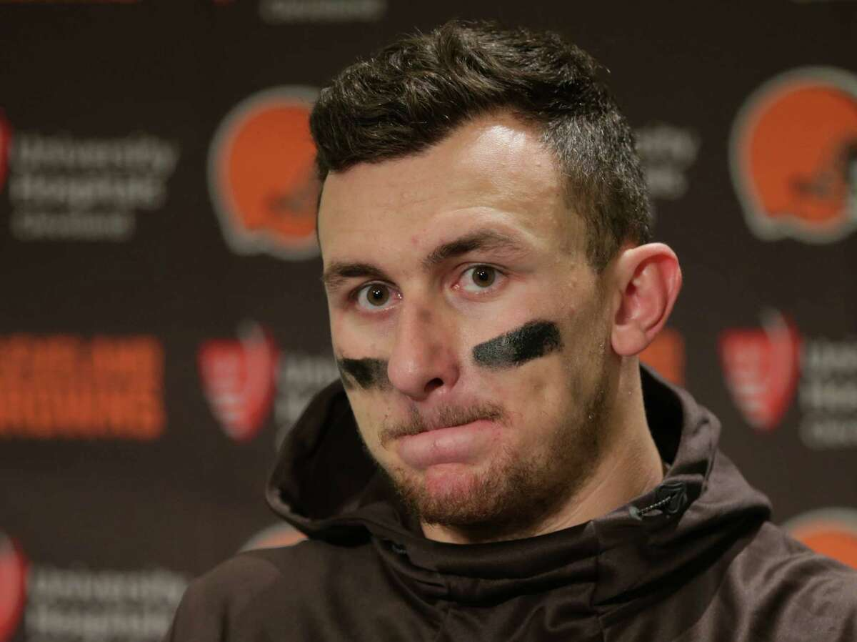 Cleveland Browns quarterback Johnny Manziel speaks with media members following the team's 30-13 loss to the Seattle Seahawks in an NFL game in December 2015.>>KEEP CLICKING FOR MORE PHOTOS OF JOHNNY MANZIEL.