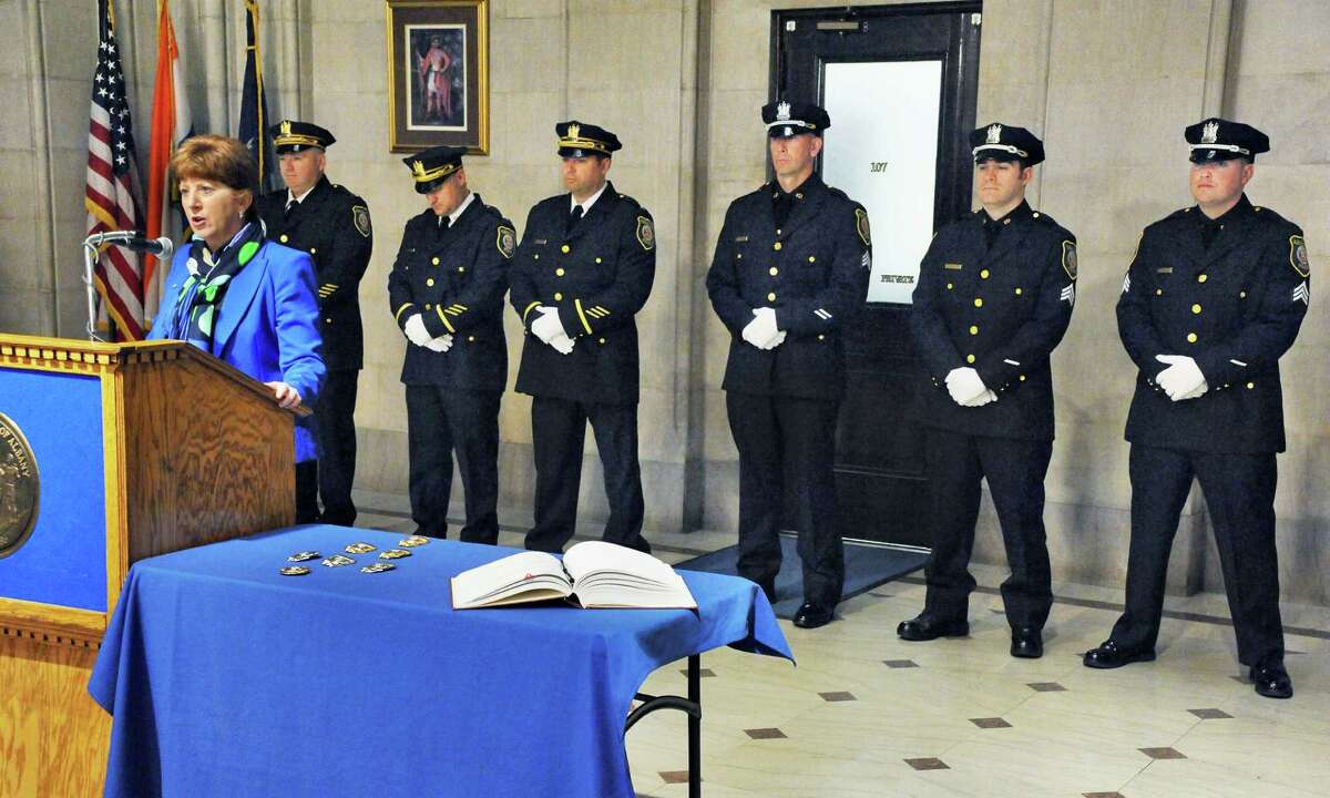 Mayor Kathy Sheehan, left, promotes current members of the Albany Police Department during a ceremony in the City Hall Rotunda on Friday morning, March 11, 2016, in Albany, N.Y. (John Carl D'Annibale / Times Union)