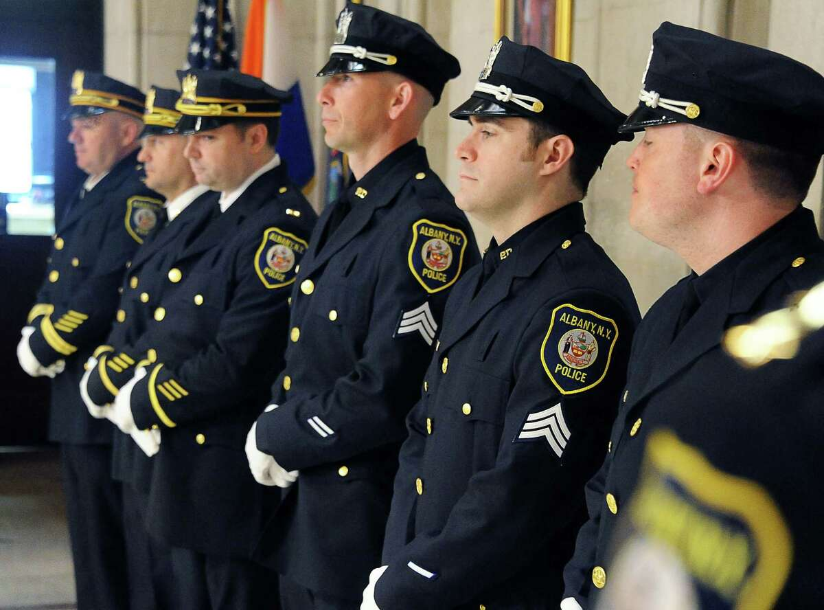 Members of the Albany Police Department stand at attention during a promotion ceremony in the City Hall Rotunda on Friday morning, March 11, 2016, in Albany, N.Y. (John Carl D'Annibale / Times Union)