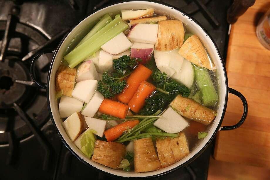 San Francisco School cook Patty Corwin boils vegetables for matzo ball soup in San Francisco, California, on thursday, march 10, 2016. Photo: Liz Hafalia, The Chronicle