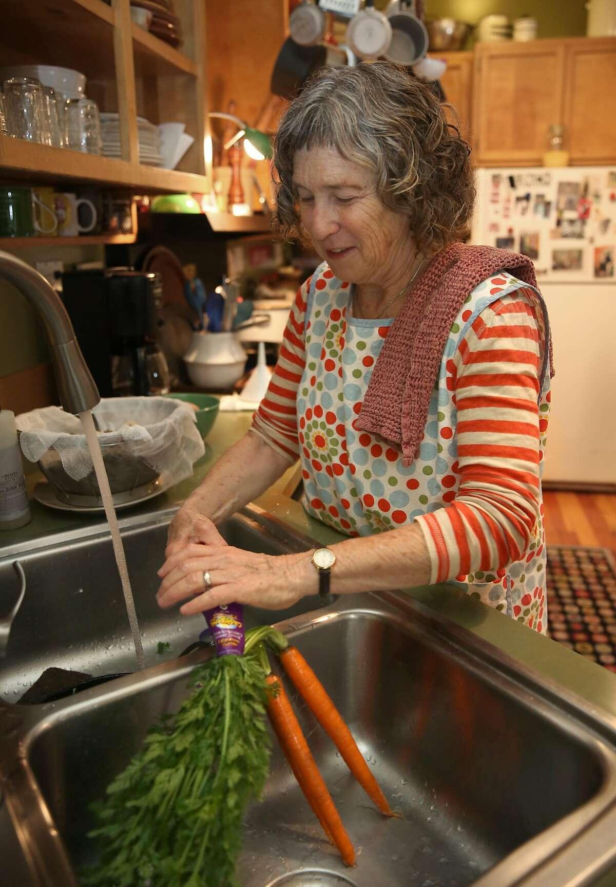 San Francisco School cook Patty Corwin washes carrots as she shows how to make matzo ball soup in San Francisco, California, on thursday, march 10, 2016.