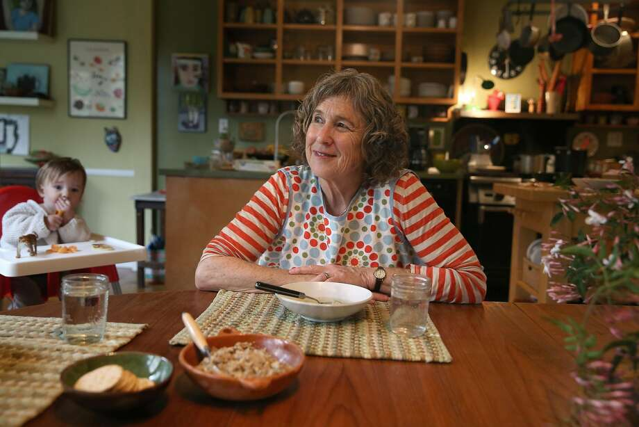 San Francisco School cook Patty Corwin has matzo ball soup at home in San Francisco with her grandson (left). Photo: Liz Hafalia, The Chronicle