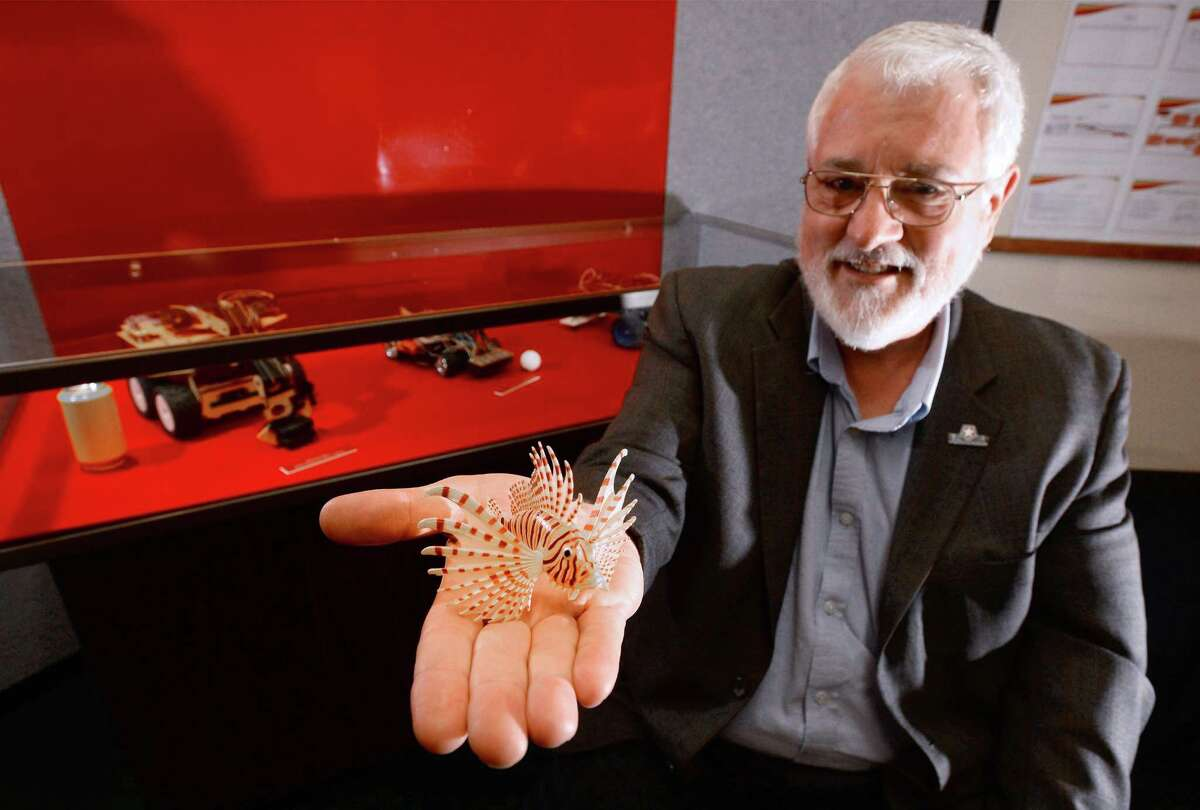 H. R. Myler a Lamar professor is working on an underwater robot that will seek out and kill invasive lionfish that are damaging the Flower Garden Banks in the Gulf of Mexico. Myler holds out a model lionfish in a room at Lamar University where student-made robots are showcased. Photo taken Thursday, March 10, 2016 Guiseppe Barranco/The Enterprise