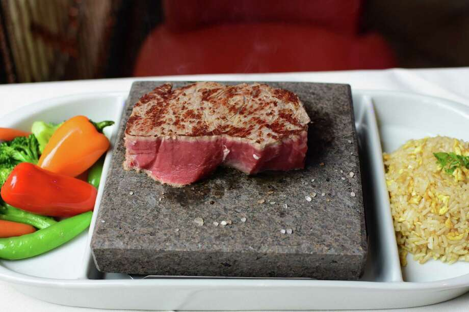 Steaks are grilled on superheated stones at customers' tables at Aji Steak Stone in Albany. Photo by Steve Barnes/Times Union)