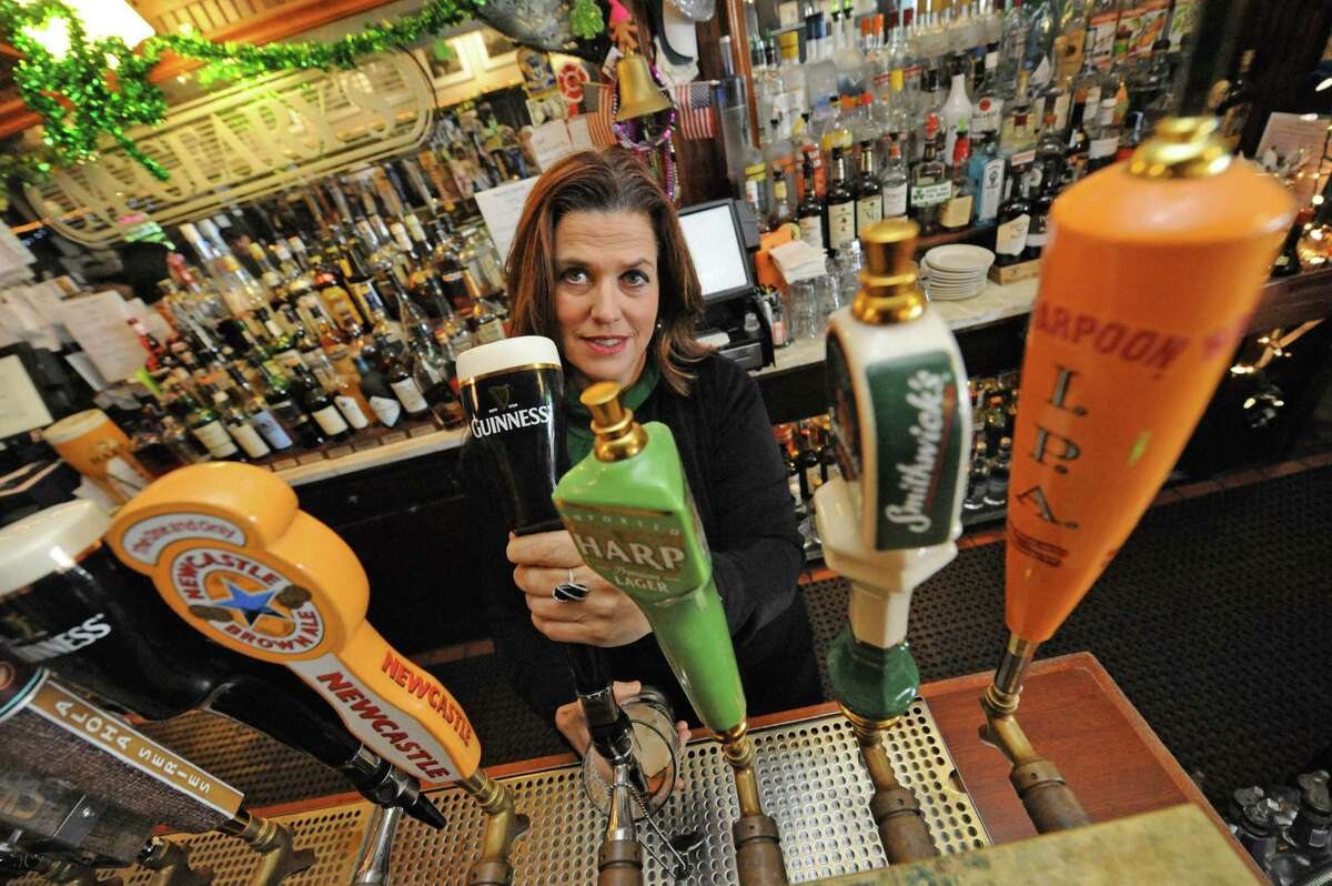 Tavern owner Tess Collins pours a Guinness at McGeary's she and staff get ready for this weekends St. Patrick's parade celebration on Thursday March 11, 2016 in Albany, N.Y. (Michael P. Farrell/Times Union)