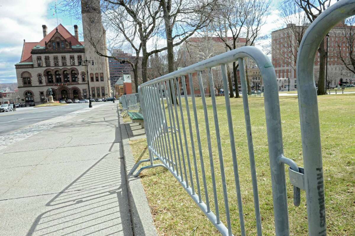 Metal fencing is seen around the lawn of the Capitol Building on Friday, March 11, 2016 in Albany, N.Y. The barriers were being put up to keep people off the lawn so the grass wouldn't be ruined during the St. Patrick's Day Parade. (Lori Van Buren / Times Union)