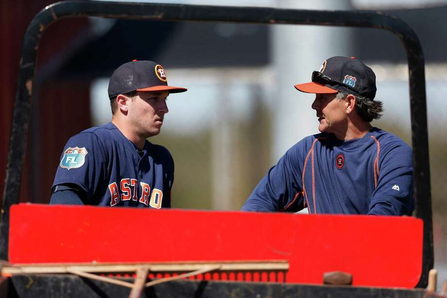 Houston Astros bench coach Trey Hillman chats with infielder Alex Bregman at the Astros spring training in Kissimmee, Florida, Friday, Feb. 26, 2016.( Karen Warren / Houston Chronicle ) Photo: Karen Warren, Staff / © 2015  Houston Chronicle