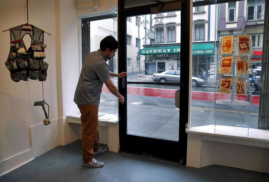 Andrew McClintock locks the door to his Ever Gold art gallery on O'Farrell Street in the Tend erloin, where it's been for seven years. McClintock is relocating to a larger space in Dogpatch. Photo: Paul Chinn, The Chronicle