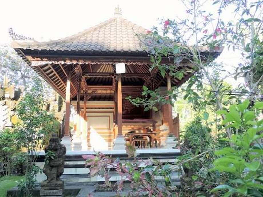 """Temple, Gianyar, Indonesia (from $14 per night):This traditional Balinese house, steps away from Pulagan Rice Field UNESCO World Heritage Site, has its very own family temple, called a """"mrajan,"""" right on its premises. Photo: Courtesy Of Homestay.com"""