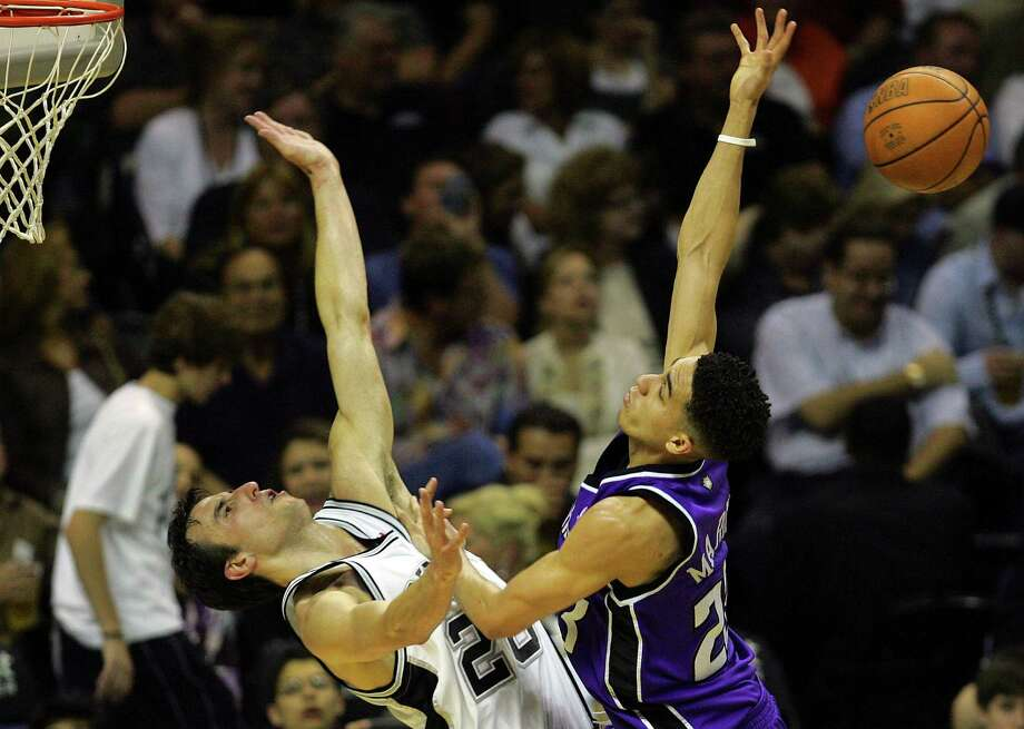 Spurs' Manu Ginobili fouls Kings' Kevin Martin during Game 5 of the first round of the Western Conference playoffs on May 2, 2006 at the AT&T Center in San Antonio. Photo: Express-News File Photo / SAN ANTONIO EXPRESS-NEWS