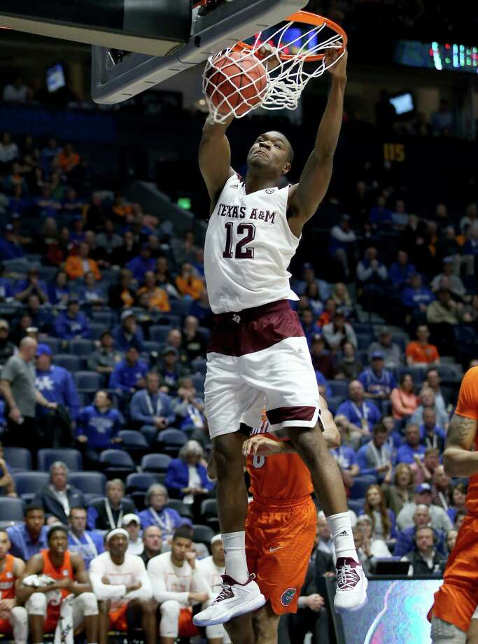 NASHVILLE, TN - MARCH 11:  Jalen Jones #12 of the Texas A&M Aggies dunks the ball in the game against the Florida Gators during the quarterfinals of the SEC Basketball Tournament at Bridgestone Arena on March 11, 2016 in Nashville, Tennessee. Photo: Andy Lyons, Getty Images / 2016 Getty Images