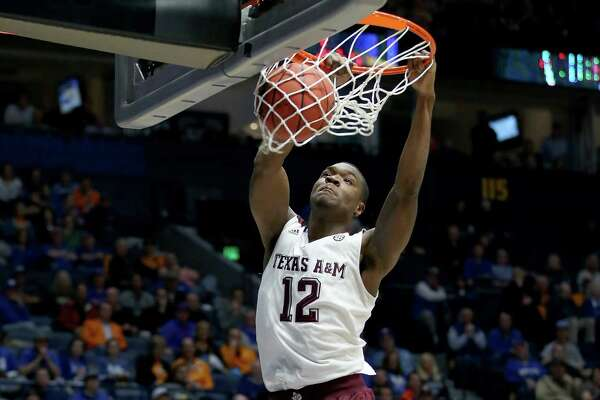 NASHVILLE, TN - MARCH 11:  Jalen Jones #12 of the Texas A&M Aggies dunks the ball in the game against the Florida Gators during the quarterfinals of the SEC Basketball Tournament at Bridgestone Arena on March 11, 2016 in Nashville, Tennessee.