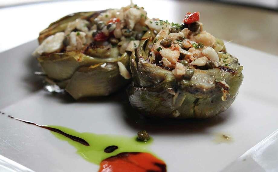 Grilled artichoke with crab vinaigrette Photo: Kin Man Hui /San Antonio Express-News / ©2013 San Antonio Express-News