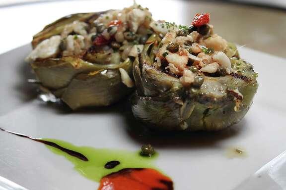 Grilled artichoke with crab vinaigrette