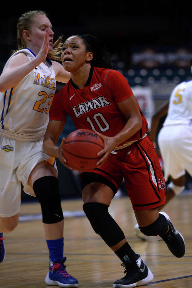 Lamar's Chastadie Barrs drives the lane against McNeese State's Amber Donnes during the second quarter in the Southland Conference tournament on Friday morning. The Cardinals lost 88-78, ending their season.  Photo taken Friday 3/11/16 Ryan Pelham/The Enterprise Photo: Ryan Pelham / ©2016 The Beaumont Enterprise/Ryan Pelham
