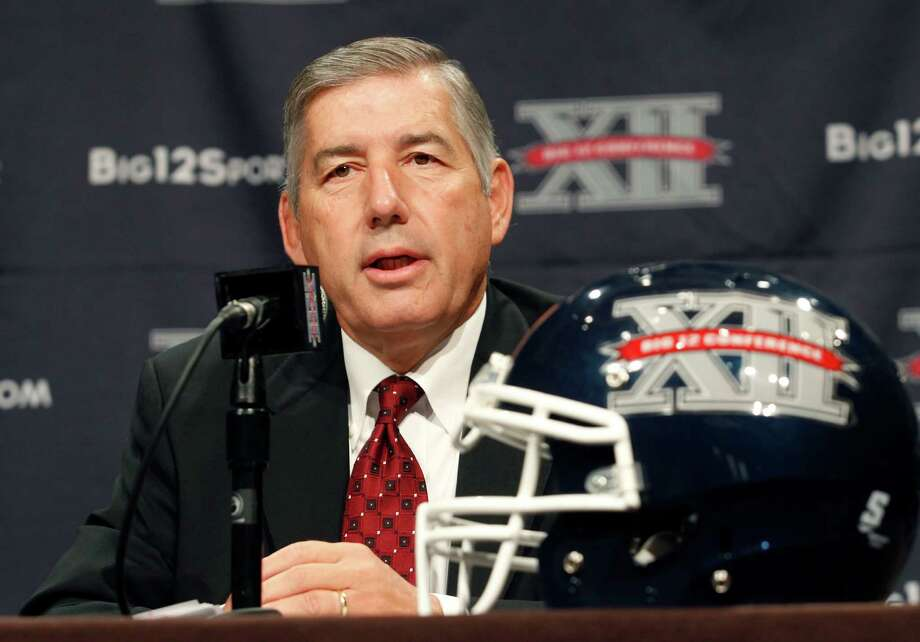 Big 12 Conference commissioner Bob Bowlsby addresses the media at the beginning of football media days in Dallas in 2013. Photo: Tim Sharp /Associated Press / FR62992 AP