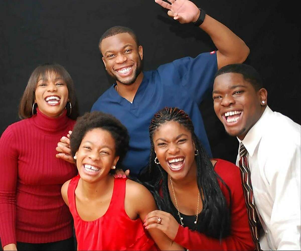 Ted Agu with his brothers and sisters