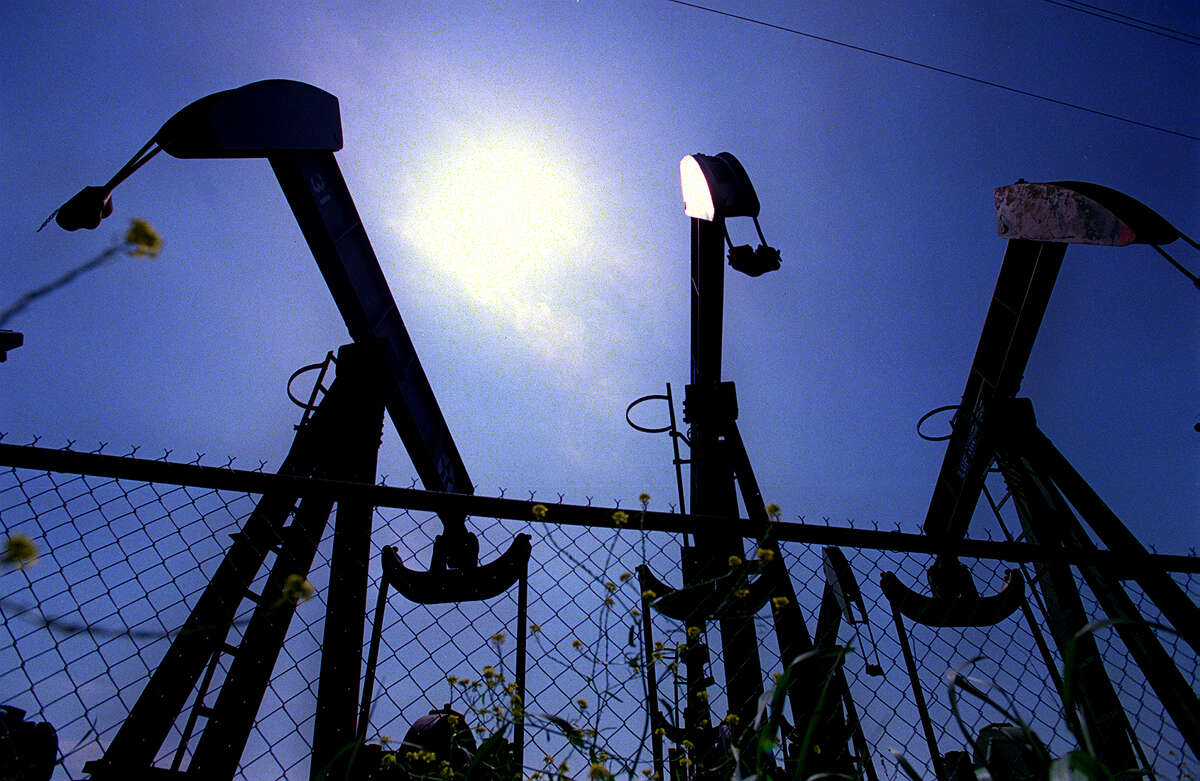 Pump jacks sit idle in a oilfield equipment yard on the outskits of Abilene. Oil drillers in the area are having a difficult time filling positions because of past layoffs and slumps in the business.