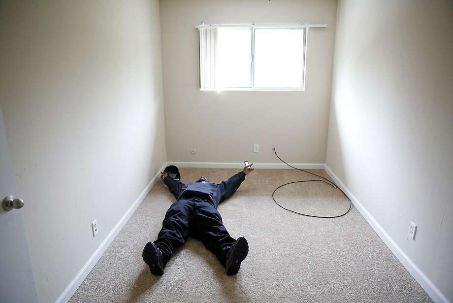 """After sleeping in his car for almost a year, Randy """"P Money"""" Harrison lays on his bedroom floor and celebrates after moving into an apartment in Benicia, Calif., on Friday, March 11, 2016. Photo: Scott Strazzante, The Chronicle"""