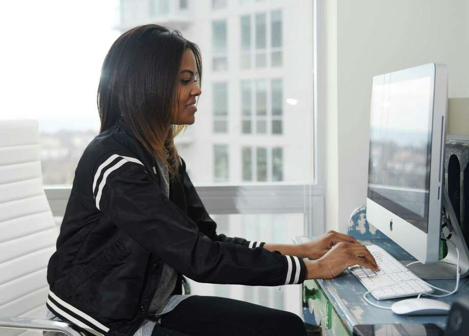 Candace Owens works in her home office in Stamford. Owens was bullied with racist threats as a Stamford High School student and is launching an anti-bullying website. Photo: Tyler Sizemore / Hearst Connecticut Media / Greenwich Time