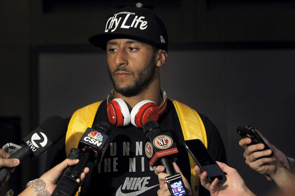 Quarterback Colin Kaepernick meets briefly with reporters before attending a team meeting at Levi's Stadium in Santa Clara, Calif. on Friday, July 31, 2015. The San Francisco 49ers open training camp Saturday.