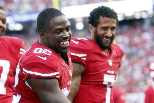 San Francisco 49ers' Torrey Smith and Colin Kaepernick enjoy Smith's 76-yard touchdown reception on sideline in 2nd quarter against Baltimore Ravens during NFL game at Levi's Stadium in Santa Clara, Calif., on Sunday, October 18, 2015.
