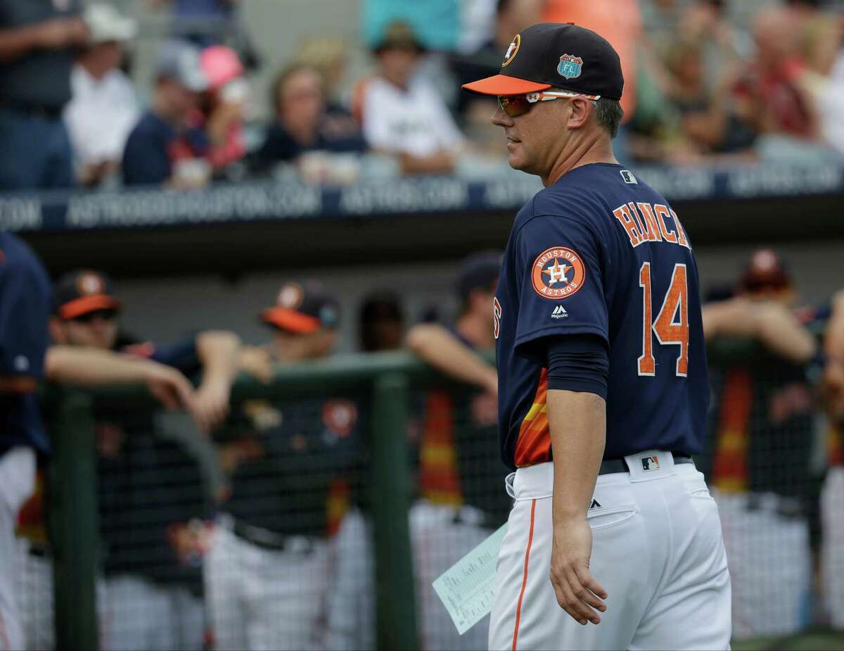 Houston Astros manager A.J. Hinch (14) walks back to the dugout after presenting the line up card to umpires before a spring training baseball game against the Detroit Tigers, Friday, March 11, 2016, in Kissimmee, Fla.