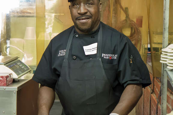 Pizzitola's Bar-B Cue pitmaster Carlton Gould was in his element in the pit room.