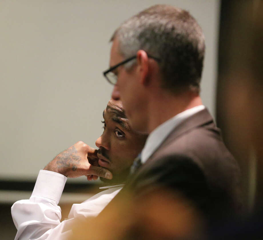 Defendant Anthony Lee Smith (hand on chin) sits with his attorney Christian Henricksen (wearing glasses) on March 9 during Smith's murder trial in the 186th District Court. Smith was convicted of killing Daniel Lee Cantu on Friday. Photo: John Davenport /San Antonio Express-News / ©San Antonio Express-News/John Davenport