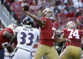 FILE - In this Oct. 18, 2015, file photo, San Francisco 49ers quarterback Colin Kaepernick (7) throws a pass in front of Baltimore Ravens strong safety Will Hill (33) during the first half of an NFL football game in Santa Clara, Calif. San Francisco general manager Trent Baalke said Wednesday, Feb. 24, 2016, he expects Kaepernick to be with the 49ers next season. (AP Photo/Marcio Jose Sanchez, File)