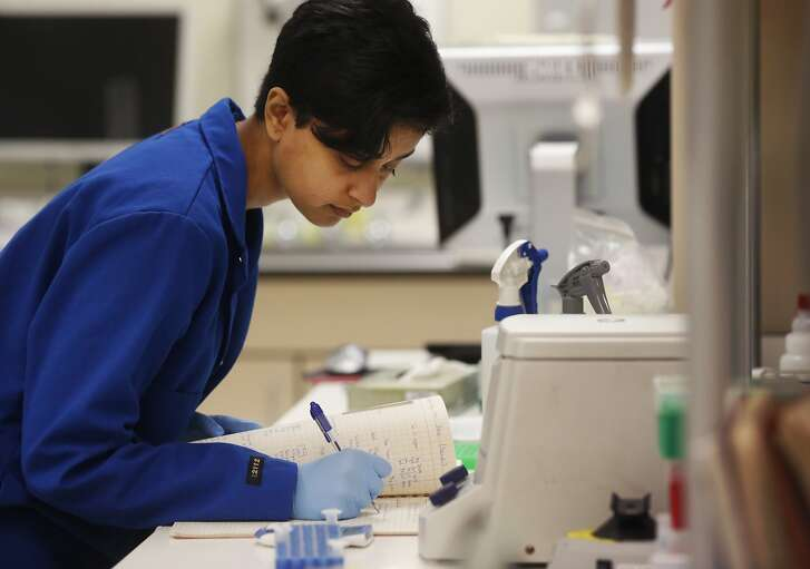 Sneha Somasekar, a staff research associate, works on testing diagnostic tests on Zika virus samples in a UCSF viral diagnostics laboratory March 2, 2016 in San Francisco, Calif.