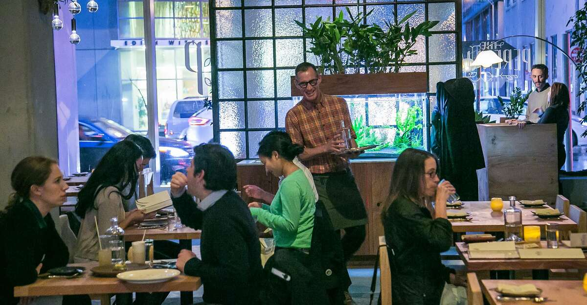 People have dinner at Perennial in San Francisco, Calif. on March 10, 2016.