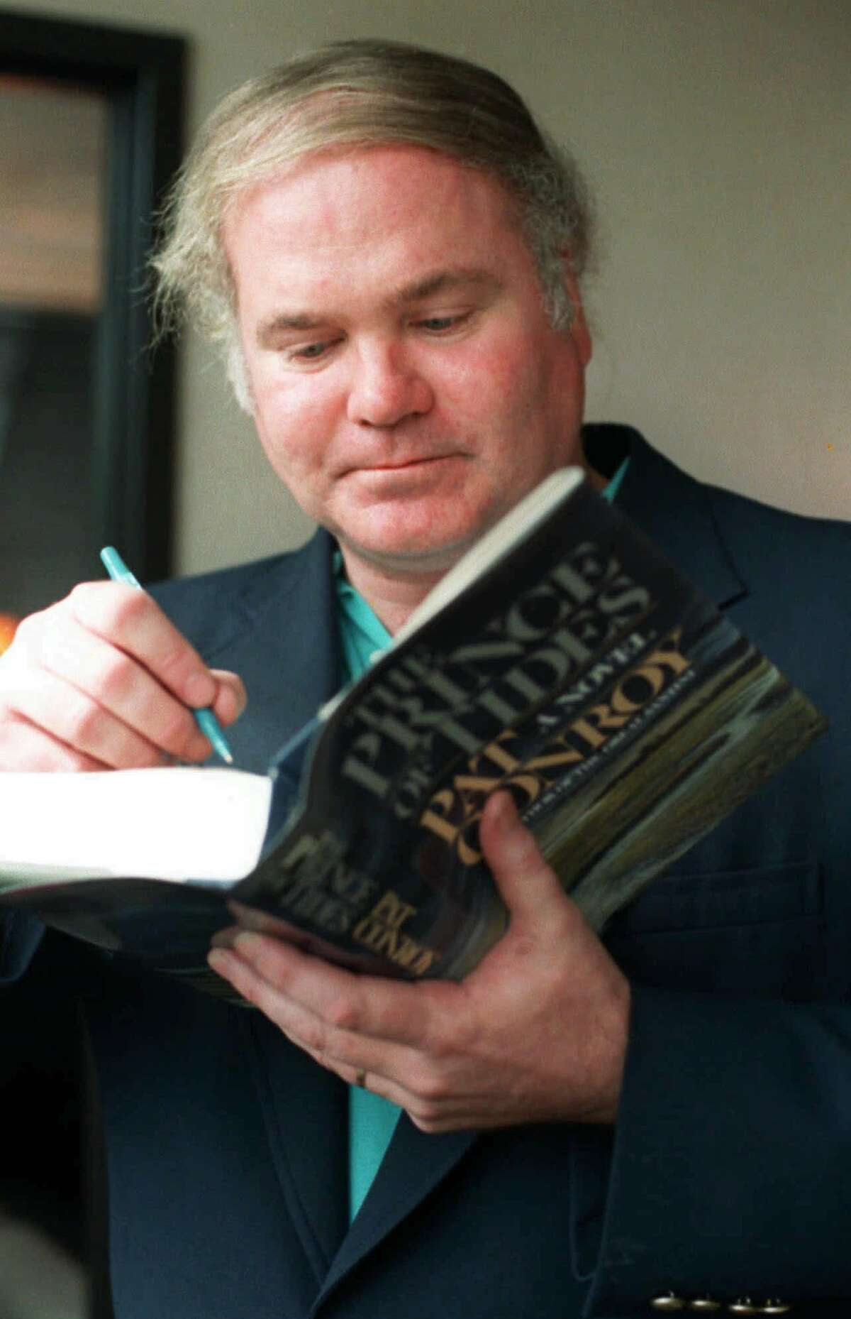 FILE--Pat Conroy is shown autographing a copy of his book, 'The Prince of Tides,' in this Oct. 20, 1986, file photo. Conroy is in negotiations with the Margaret Mitchell estate to write another sequel to the Civil War saga 'Gone With the Wind,' according to published reports saying the deal might be worth $10 million. (AP Photo/H. Joe Holloway Jr., File)
