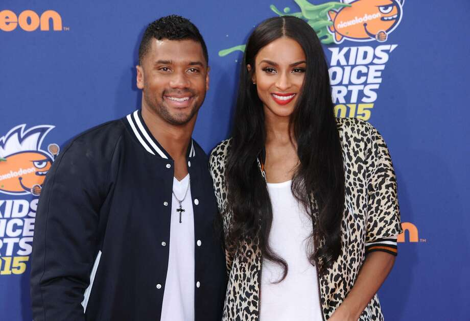 FILE - In this July 16, 2015 file photo, Seattle Seahawks quarterback Russell Wilson, left, and singer Ciara arrive at the 2015 Kids' Choice Sports Awards in Los Angeles. A representative for Ciara confirms that the couple are engaged. Russell posted a video on his Facebook page Friday, March 11, 2016, showing himself next to Ciara, who was wearing a bright ring.  (Photo by Richard Shotwell/Invision/AP, File) Photo: Richard Shotwell, Richard Shotwell/Invision/AP