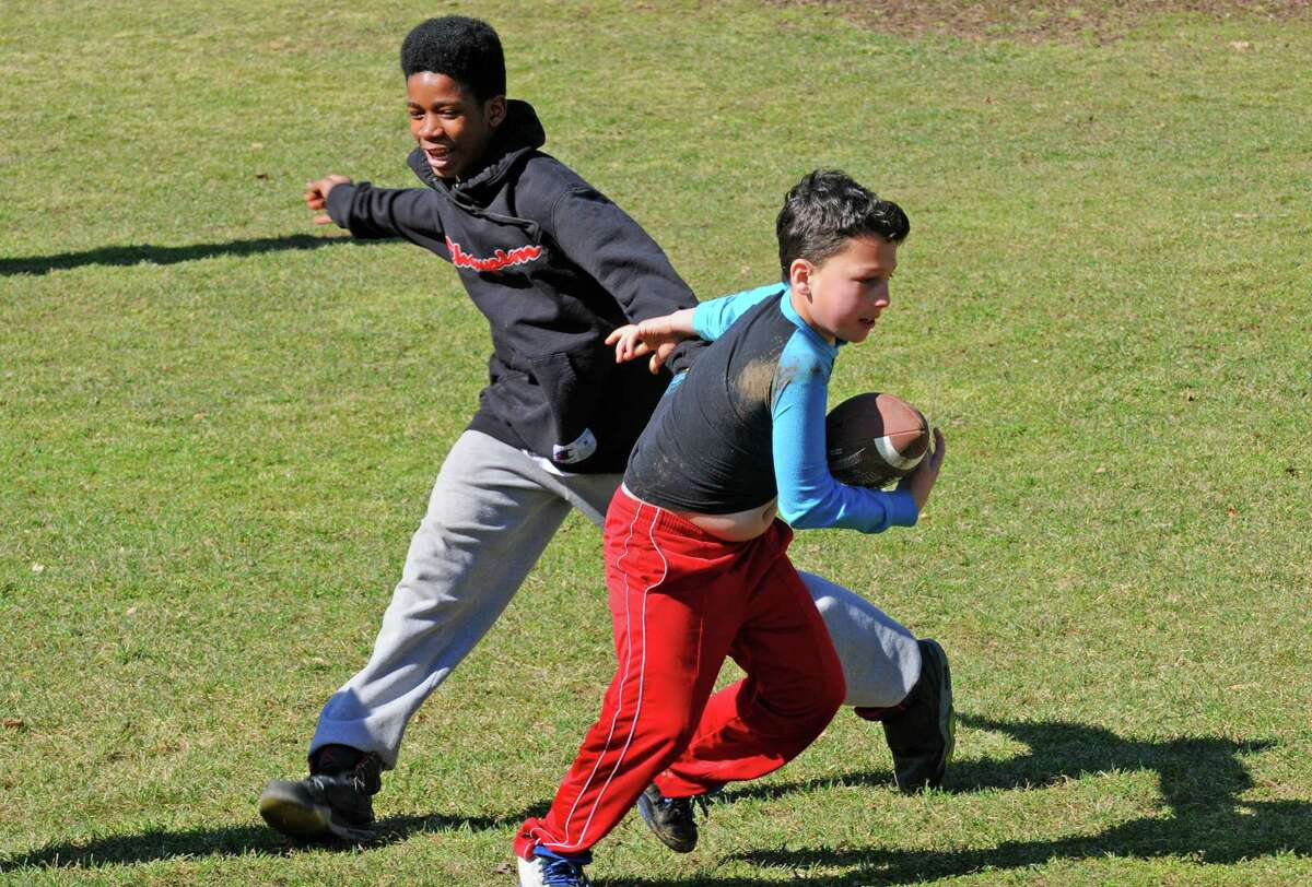 Davyjian Grier, left 13, and Antonio Guynup, 10, both of Troy play football at Washington Park on Friday March 11, 2016 in Albany, N.Y. (Michael P. Farrell/Times Union)