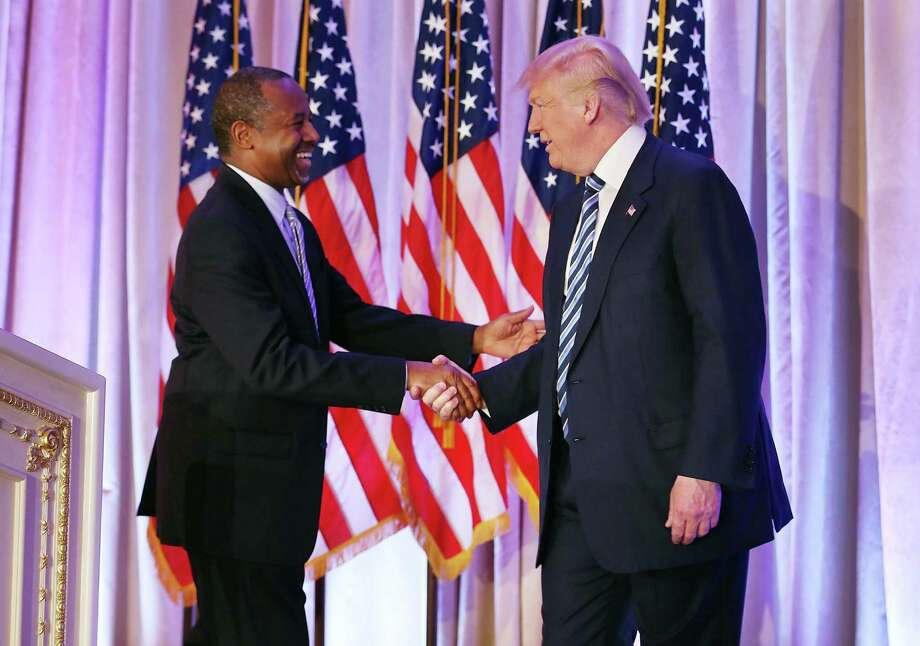PALM BEACH, FL - MARCH 11:  Republican presidential candidate Donald Trump shakes hands with former presidential candidate Ben Carson as he receives his endorsement at the Mar-A-Lago Club on March 11, 2016 in Palm Beach, Florida. Presidential candidates continue to campaign before Florida's March 15th primary day.  (Photo by Joe Raedle/Getty Images) *** BESTPIX *** Photo: Joe Raedle, Staff / 2016 Getty Images