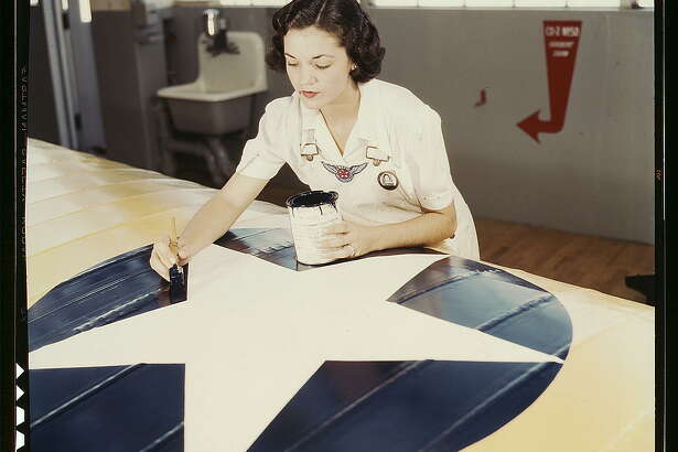 Painting the American insignia on airplane wings is a job that Mrs. Irma Lee McElroy, a former office worker, does with precision and patriotic zeal. Mrs. McElroy is a civil service employee at the naval Air Base, Corpus Christi, Texas. Her husband is a flight instructor (1942 August)