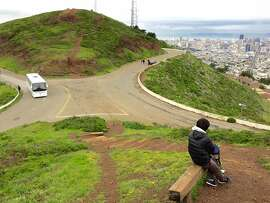 The east side of Twin Peaks Boulevard (to the right) would be closed to traffic as part of a pilot project by the city to improve hiking and pedestrian access to the scenic spot. Critics say it will make it more dangerous and harder to find parking.