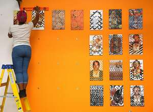 "California College of the Arts artist Tosha Stimage installs her artwork called ""50 Ways to Make Orange""--woven collage, 2016--at 1275 Minnesota St., one of a new cluster of art galleries in a converted warehouse opening next week in San Francisco, California, and seen on friday, march 11, 2016."