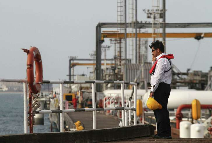 An Iranian technician stands at an oil facility in the Khark Island. OPEC members Saudi Arabia and Iran, whose rivalry sunk an oil supply accord earlier this year, met in Vienna along with fellow OPEC member Qatar at the group's Vienna headquarters, according to three people familiar with the matter. Face-to-face talks between Saudi Arabia and Iran show diplomatic efforts to secure a meaningful deal in Algiers are still underway despite market skepticism.