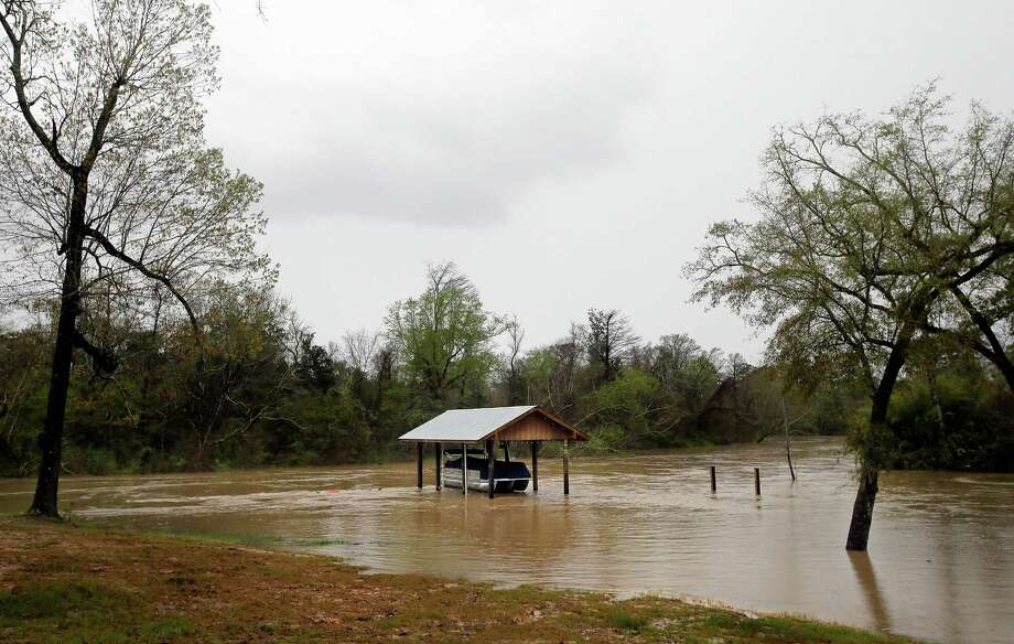 David Skansi's boat is stranded in the boat house on the Bogue Falaya River at South New Hampshire Street in Covington, La., Friday, March 11, 2016. (David Grunfeld/NOLA.com The Times-Picayune via AP) Photo: David Grunfeld, MBR / AP / The Times-Picayune