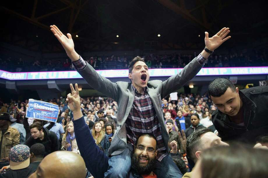 CHICAGO, IL - MARCH 11:  Demonstrators celebrate after it was announced that a rally with Republican presidential candidate Donald Trump at the University of Illinois at Chicago would be postponed on March 11, 2016 in Chicago, Illinois. Organizers postponed the rally citing safety reasons after hundreds of demonstrators were ticketed for the event.  (Photo by Scott Olson/Getty Images) Photo: Scott Olson, Staff / Getty Images / 2016 Getty Images