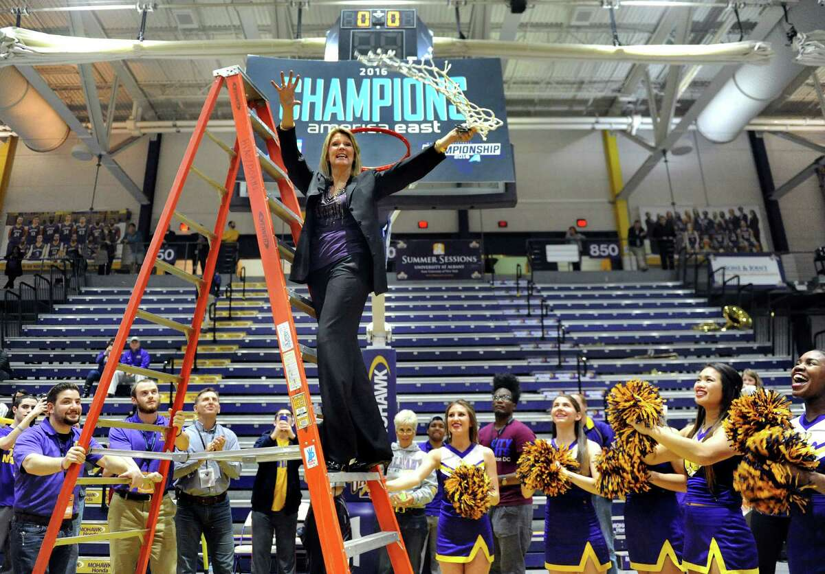 UAlbany coach Katie Abrahamson-Henderson, center, twirls the net after cutting it down as the team celebrates its 59-58 win over Maine in the America East Women's Basketball Championship game on Friday, March 11, 2016, at SEFCU Arena in Albany, N.Y. (Cindy Schultz / Times Union)