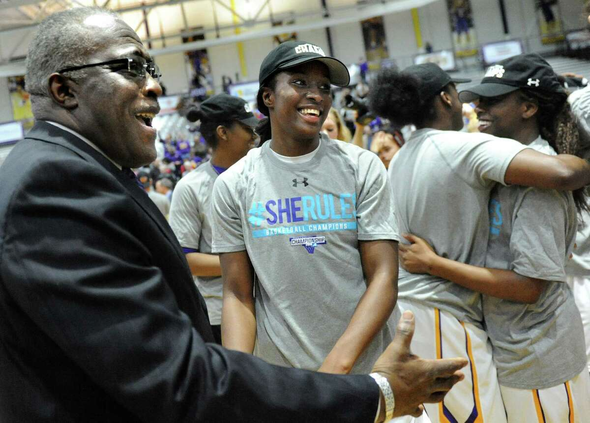 UAlbany's President Robert Jones, left, congratulates Shereesha Richards, center, and her team as they celebrate their 59-58 win over Maine in the America East Women's Basketball Championship game on Friday, March 11, 2016, at SEFCU Arena in Albany, N.Y. (Cindy Schultz / Times Union)